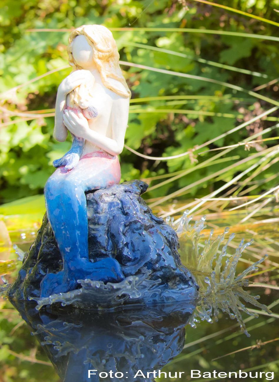 zeemeermin-op-rots